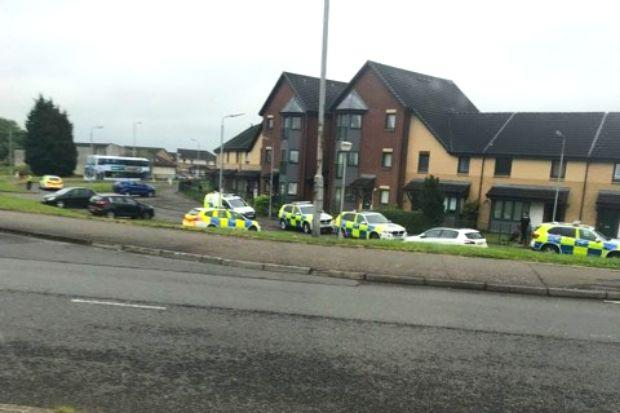 Police and armed officers storm street near Glasgow Fort