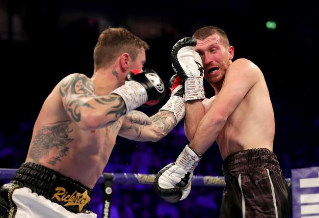 MANCHESTER, ENGLAND - NOVEMBER 10:  Ricky Burns of England punches Scott Cardle of England during the Lightweight Contest between Ricky Burns and Scott Cardle at Manchester Arena on November 10, 2018 in Manchester, England.  (Photo by Richard Heathcote/Ge