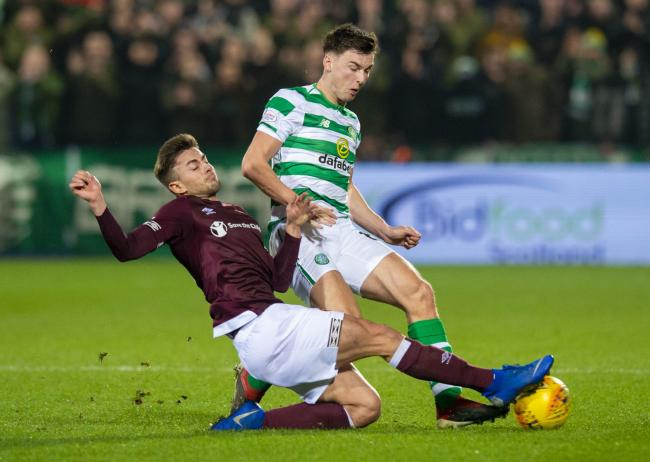 27/02/19 LADBROKES PREMIERSHIP.HEARTS v CELTIC (1-2).TYNECASTLE PARK - EDINBURGH.Hearts' Marcus Godinho (left) tackles Celtic's Kieran Tierney.