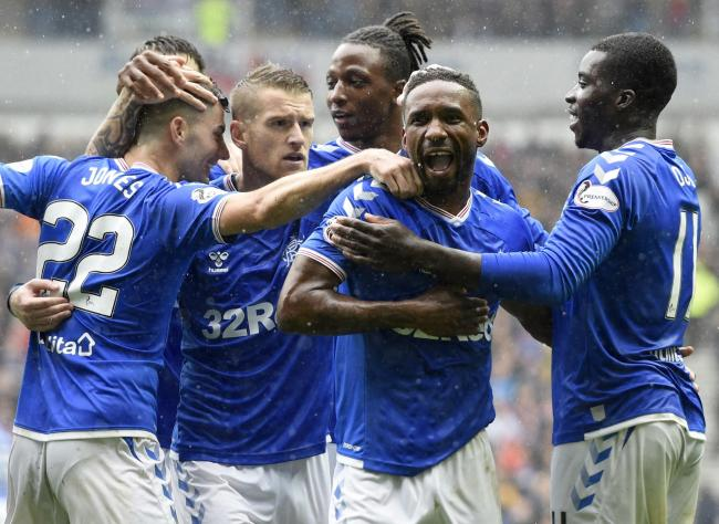 Jermain Defoe (centre) celebrates after scoring his sides second goal during the Ladbrokes Scottish Premiership match at Ibrox
