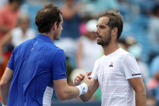 Andy Murray shakes hands with Richard Gasquet of France after losing in straight sets during Day 3 of the Western and Southern Open. Picture: Getty