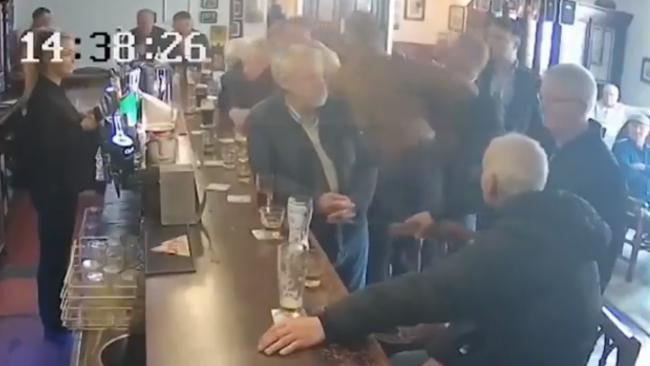 CCTV footage shows Conor McGregor punching an old man in the heaD