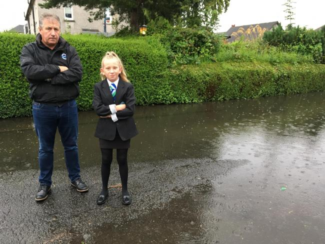 Flooded street forces dad to drive daughter just 50 yards to catch school bus