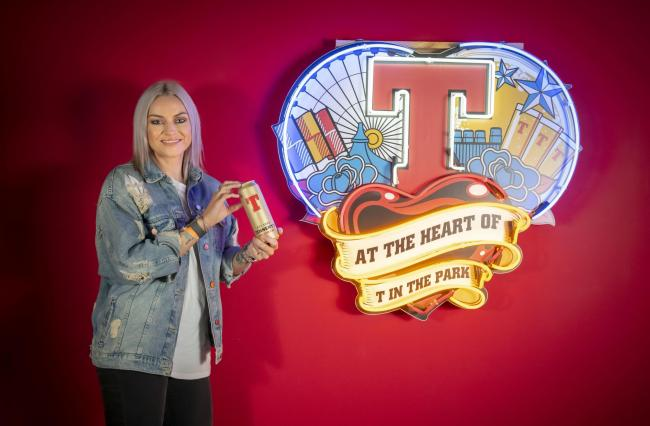 Singer Amy McDonald receives the Tennent's golden can at the Tennent's visitor centre in Glasgow..Copyright photo by Paul Chappells, 07774730898www.paulphoto.co.uk