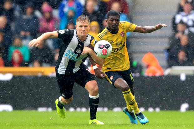 Arsenal's Ainsley Maitland-Niles (right) and Newcastle United's Matt Ritchie battle for the ball during the Premier League match at St James' Park, Newcastle. PRESS ASSOCIATION Photo. Picture date: Sunday August 11, 2019. See PA story SOCCER