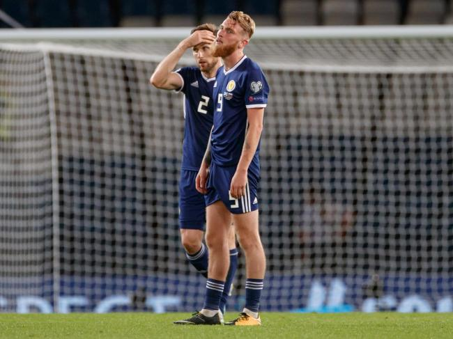 Stephen ODonnell and Oli McBurnie can't hide their disappointment after the defeat by Russia