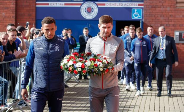 Evening Times: The Rangers squad and staff paid tribute