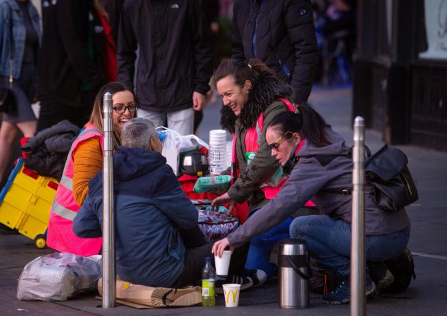 Shots of rough sleepers and volunteers from Help the Homeless.