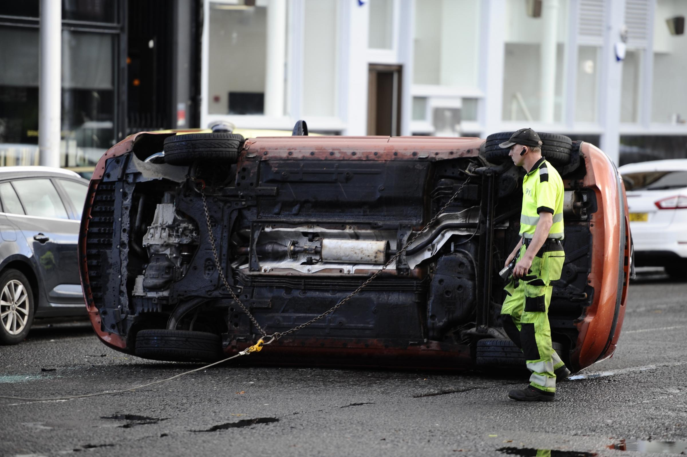 Driver in hospital after car flips near Govan Cross causing road closures