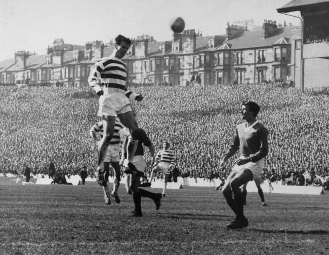 Celtic's Billy McNeill heads the ball over Rangers' Ron McKinnon