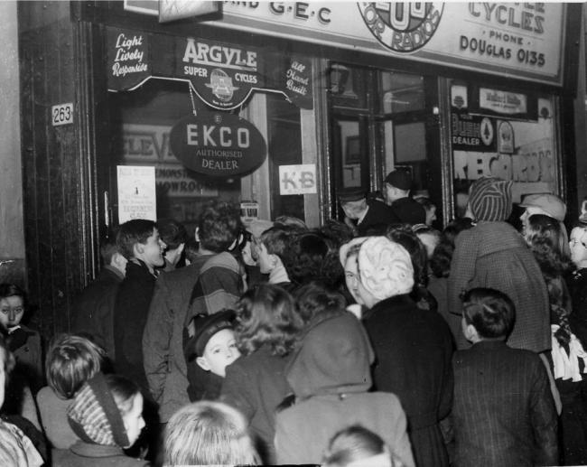Crowd Gathers Outside Shop Window to Watch First Scottish Television Broadcast in 1952