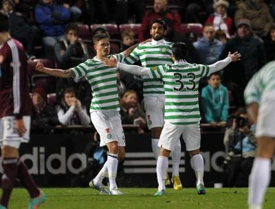 Mikael Lustig (left) celebrates scoring the second goal