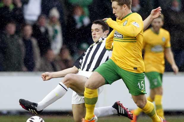 Saint Mirren's John McGinn and Celtic's Kris Commons battle for the ball