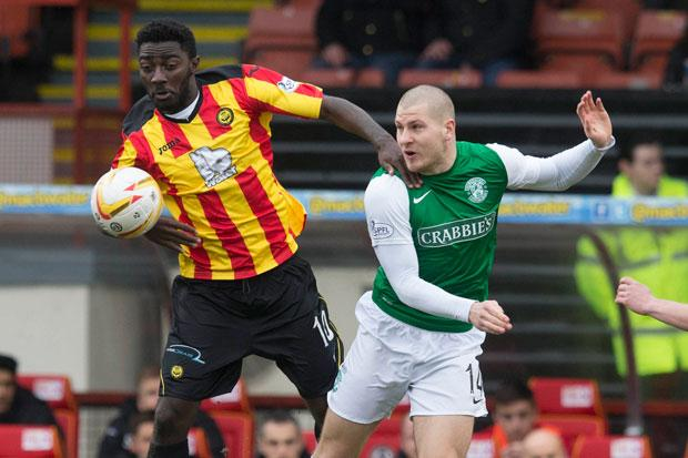 Partick Thistle's Prince Buaben (right) and Hibernian's James Collins