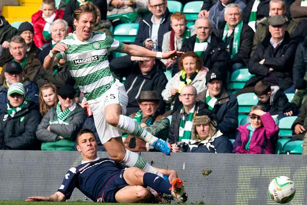 Ross County's Filip Kiss slides into Celtic's Stefan Johansen (right)