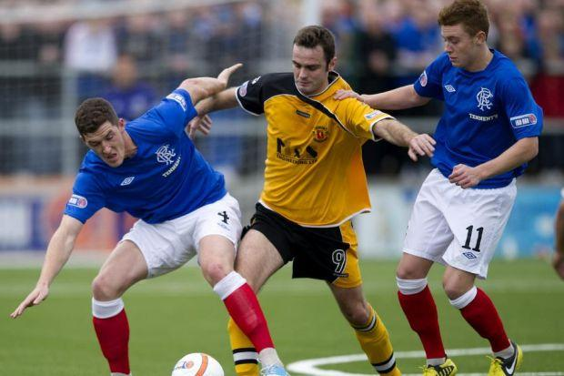 Lewis Macleod, far right, has played in every Rangers game this season, and has made a huge impression on Ian Durrant