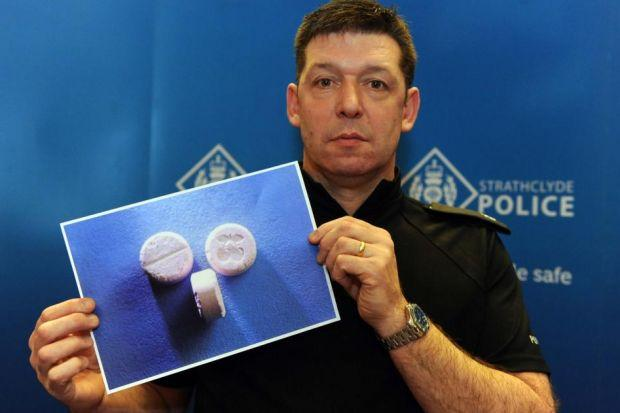 Superintendent Kirk Kinnell shows what the harmful drugs look like