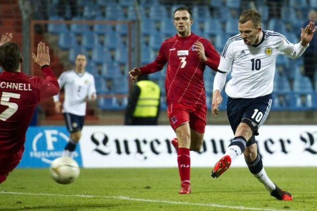 Jordan Rhodes showed his striker's instinct by pouncing on the ball to fire Scotland into a two-goal lead last night