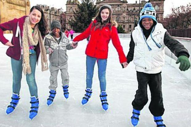 These youngsters were among the first to enjoy George Square's festive ice rink
