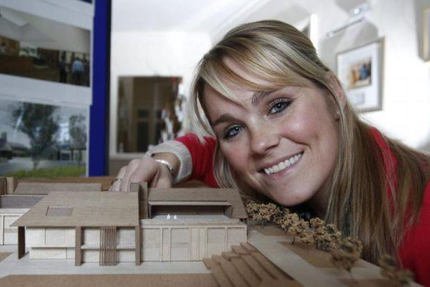 Nicola Malcolm with a model of the new hospice at the Prince And Princess Of Wales Hospice