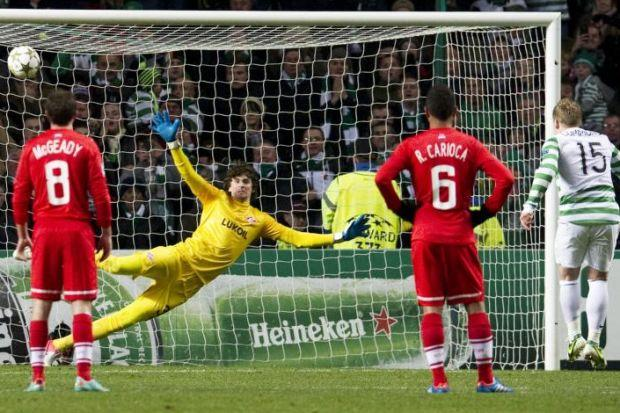 Kris Commons slams home the penalty kick which sent Celtic into the last 16 of the Champions League