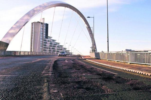 The northbound carriageway's inside lane on the Clyde Arc has a pothole which extends for around 30ft up to the road junction