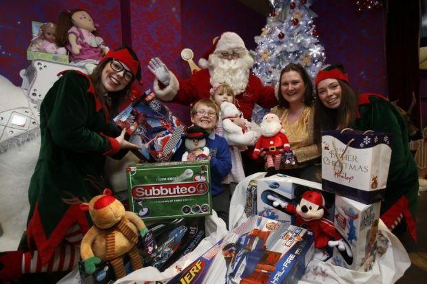 Alexander Gibson with mum Catriona, sister Katie Beth, 3, Santa and his two elves at Hamleys in the St Enoch Centre