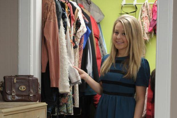 n Marion, who is regional sales manager at jewellers Dower and Hall,  at home in Shawlands with some of her favourite wardrobe items.  Pictures:  Kirsty Anderson