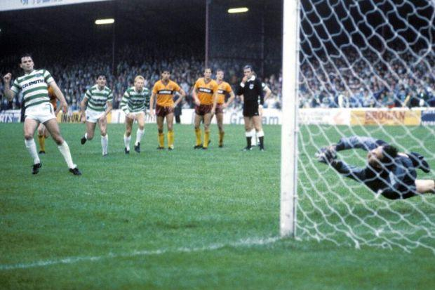Celtic's Brian McClair beats Motherwell keeper John Gardiner from the penalty spot durin