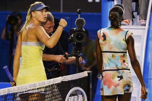 Maria Sharapova salutes the crowd as Venus Williams troops off court