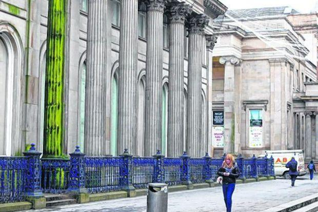 A leaking pipe has been blamed for creating the algal bloom on the column at the Gallery of Modern art