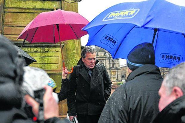 John McAslan braved the rain in George Square to explain his plans to members of the public