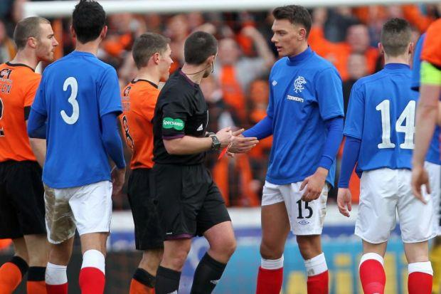 Kal Naismith receives his marching orders by referee Euan Morris