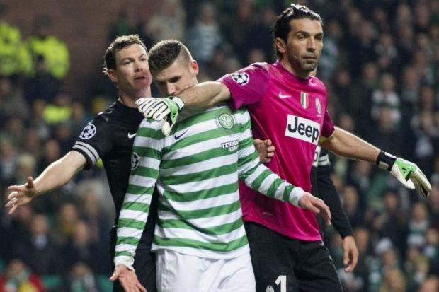 Celtic striker Gary Hooper is caught in a tangle of arms as Juventus pair Stephan Lichstenier and Gigi Buffon take the laws to the limit
