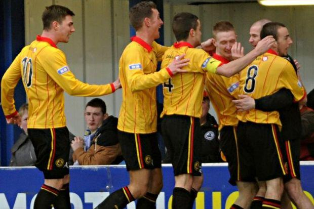 Chris Erskine and team-mates celebrate the game's opening goal with interim boss Alan Archibald