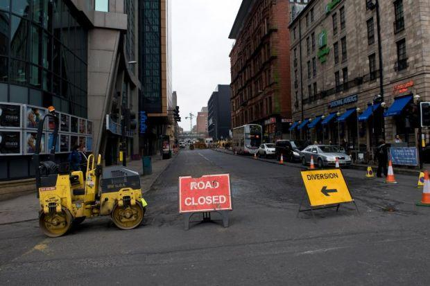 Motorists say the road surface at a busy city centre junction is sinking