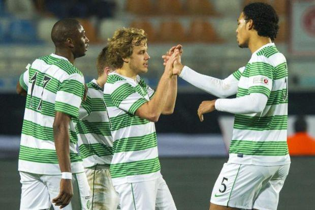 Virgil van Dijk congratulates Teemu Pukki on his goal last night, and the Dutch defender has been a star for Celtic since being brought in to replace stopper Kelvin Wilson