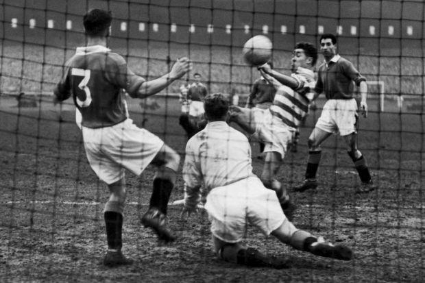 Bobby Collins scores for Celtic against Rangers in a Scottish Cup match in 1957 which ended 4-4 at Parkhead; with Celtic winning 2-0 in the replay at Ibrox