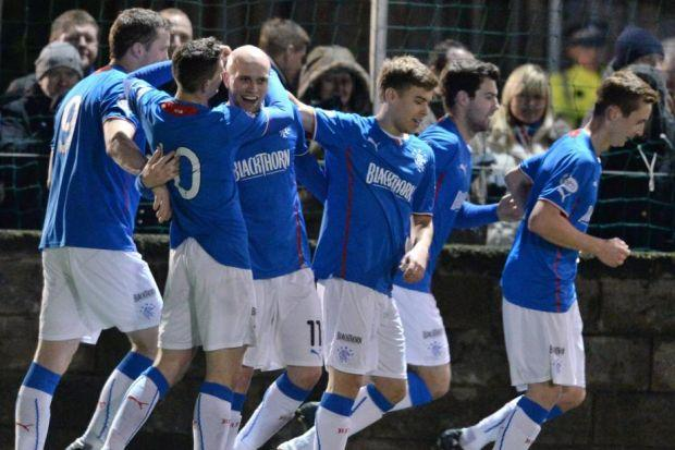 Nicky Law celebrates with his team-mates after scoring the second of his two goals against Stenhousemuir in Rangers' 2-0 win at Ochilview