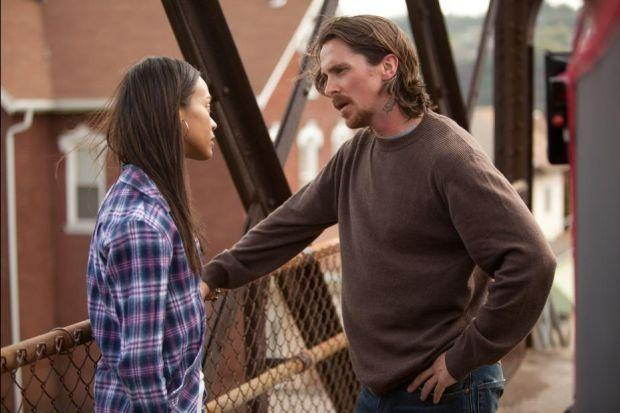 Christian Bale plays a man who loses his liberty and his girlfriend (Zoe Saldana) after he is sent to jail