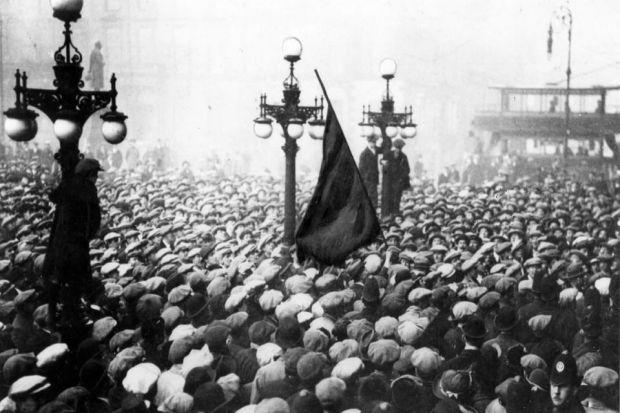 Archive pictures show workers packed into Glasgow's George Square, and the raising of the red flag