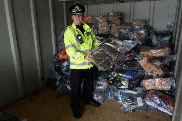 Chief Inspector David Pettigrew with some of the seized goods