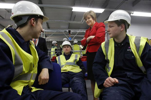 Deputy First Minister Nicola Sturgeon chats to students during a visit to West College Scotland in Paisley to announce government plans to create 3,500 new college places.