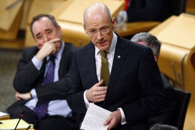 Finance Secretary John Swinney delivers his budget speech at Holyrood, watched by Alex Salmond