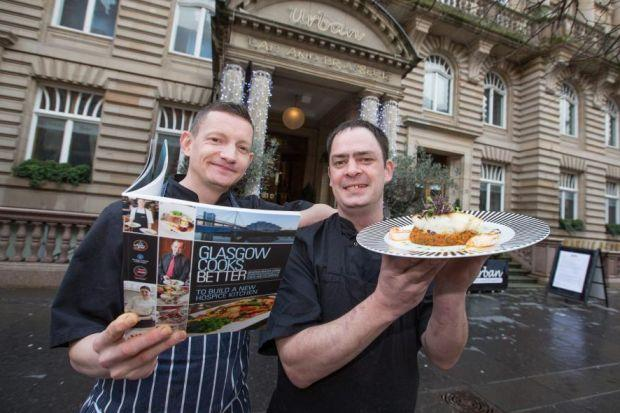 Urban Bar & Brasserie sous chef Colin Penny and head chef Dave Clunas with his dish and new recipe book