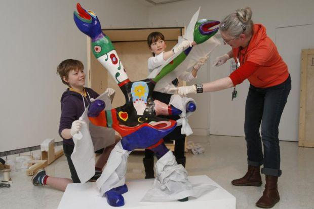 Pupils Johnny Taylor and Catriona Ferguson wrap a sculpture