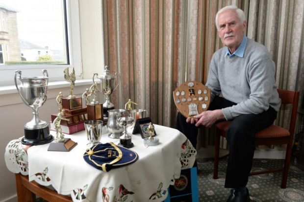 George McKenzie shows off the array of prizes he has from a remarkable football career. Exclusive picture: Nick Ponty