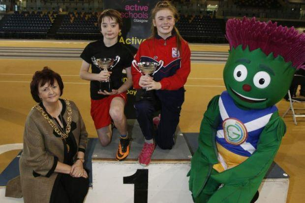 Lord Provost Sadie Docherty and Games mascot,  Clyde the Thistle, present Phoebe McInally and Sonny Campbell with their awards             Picture: Mark Gibson