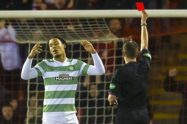 Virgil van Dijk receives his red card from referee Craig Thomson