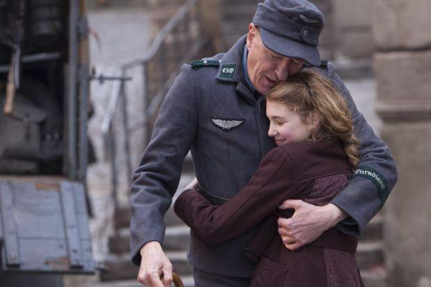 Geoffrey Rush and Sophie Nelisse as Liesel and her adoptive father